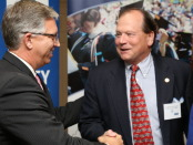 North Carolina Community College System President, Dr. R. Scott Ralls (left) thanks Nash Community College President Dr. Bill Carver for his support of a revised Independent Comprehensive Articulation Agreement between community colleges and four-year colleges and universities at a ceremony last week.
