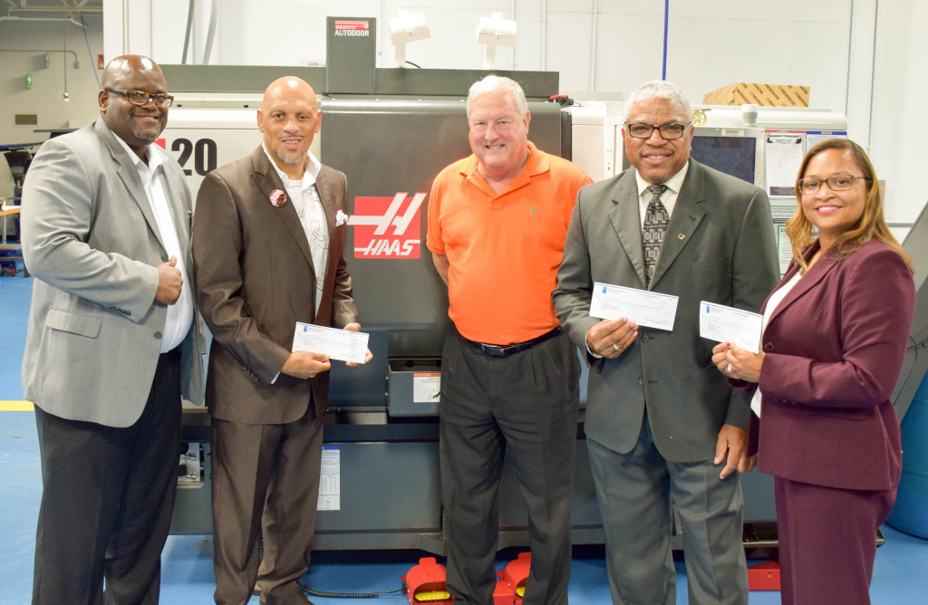 """Pictured from left: Nash Rocky Mount Schools Superintendent Dr. Shelton Jeffries, Board of Education Chair Reginald Silver, Phillips Corporation Sales Engineer Steve Price, Board of Education Vice Chair William """"Bill"""" Sharpe, Nash Rocky Mount Schools Director of Career and Technical Education Pamela Lewis."""